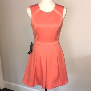Hot Coral, fit and flare Bebe mini dress.